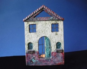 Ceramic house with tiles for candle