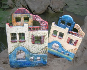 Ceramic island style houses for candles