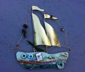 Ceramic ship for wall with brass